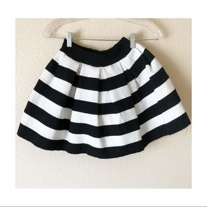 Small black and white pleated skirt